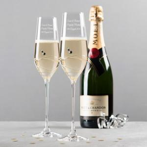 engraved set of two swarovski crystal champagne flutes swirls a